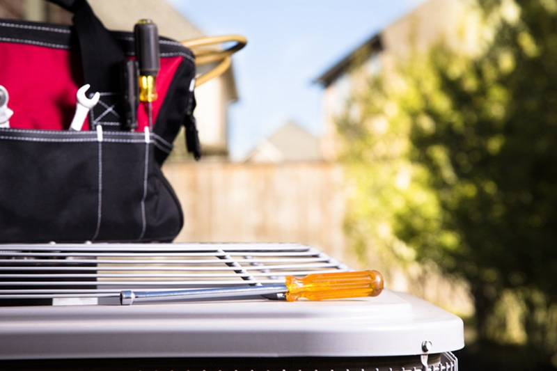 tool box on AC unit outside